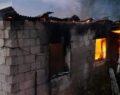 Evinin yanışını çaresizce izledi